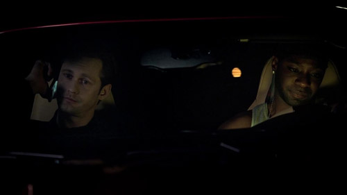 Eric and Lafayette in Lafayette's car.
