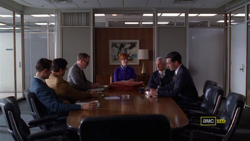 Mad Men 4x03 The Good News gathered around the table
