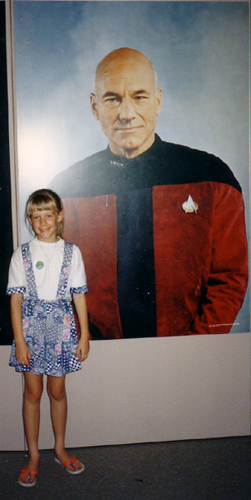 Erica standing in front of a poster of Captain Picard.