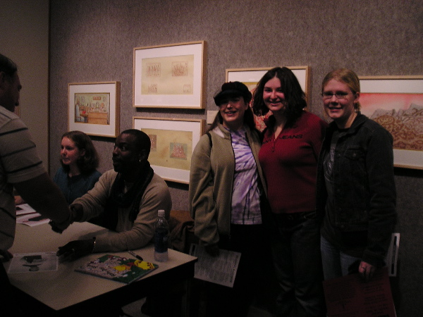Erica standing with friends next to LeVar at a signing.