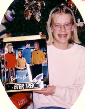 Erica on her 13th birthday with her Star Trek Barbie dolls