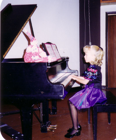 Erica playing the piano at her very first recital.