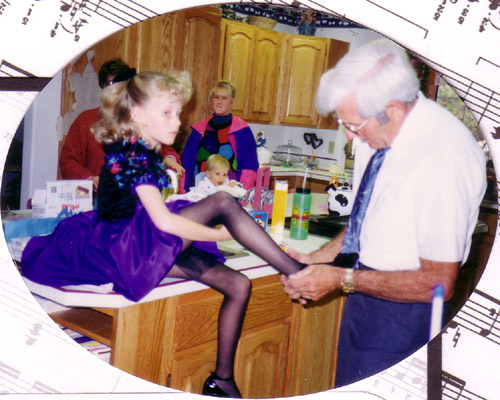 Grandpa helps Erica get ready for her first piano recital.