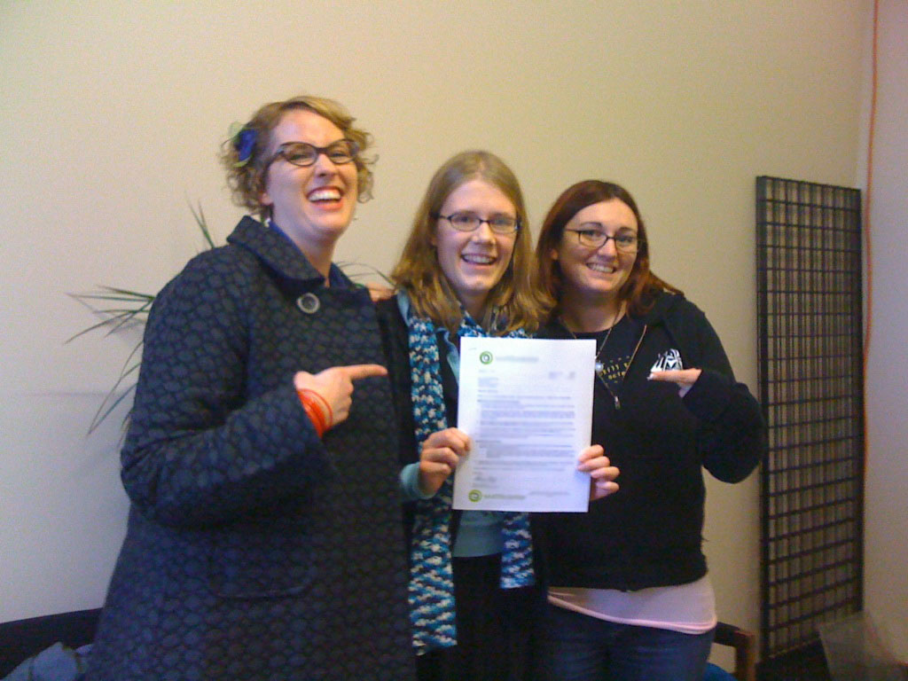 Jen, Erica, and Marissa with the signed contract
