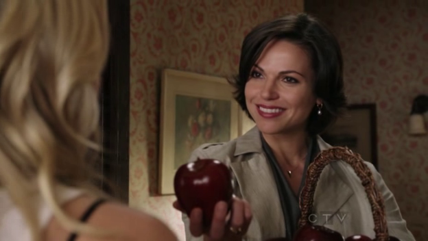 Regina shows up baring apples
