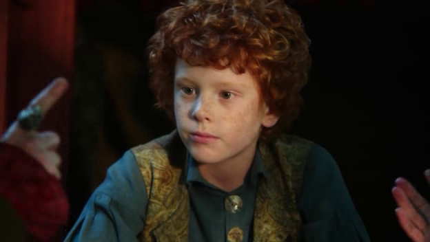 Jiminy as a child. A small ginger child.